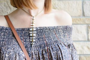fall outfit inspiration kendra scott necklace off the shoulder top